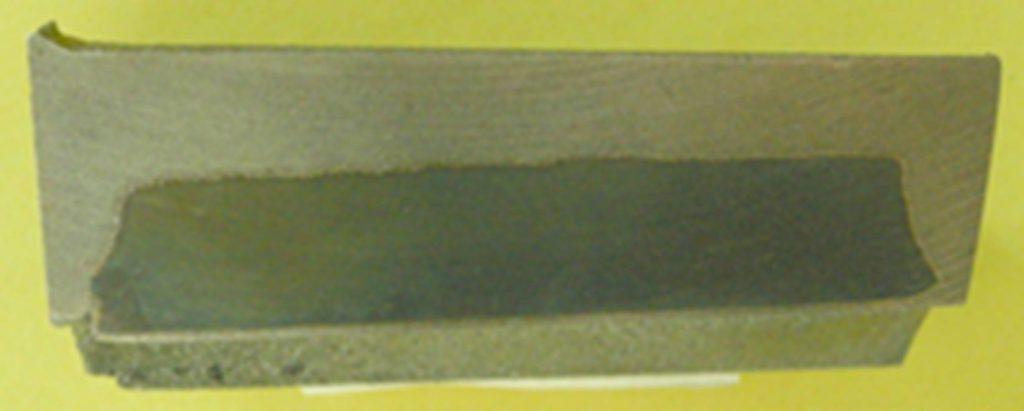 Liaison métallurgique avec un insert inséré à la coulée.