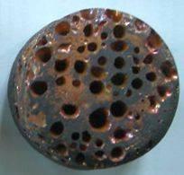 Rochage sur échantillon avec un alliage de cuivre.